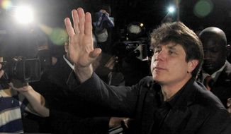 FILE - In this March 15, 2012 file photo, former Illinois Gov. Rod Blagojevich waves as he departs his Chicago home for Littleton, Colo., to begin his 14-year prison sentence on corruption charges. On Tuesday, Aug. 4, 2015, lawyers for Blagojevich filed a request with the 7th U.S. Circuit Court of Appeals in Chicago to rehear his appeal after three judges recently overturned five of his 18 corruption convictions. Blagojevich is hoping the full court will overturn more counts. Full-court hearings aren't granted automatically. (AP Photo/Charles Rex Arbogast, File)