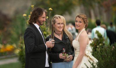 "This photo provided by courtesy of Sony Pictures shows, Rick Springfield, from left, as Greg, Meryl Streep, as Ricki, and Mamie Gummer as Julie, in TriStar Pictures' ""Ricki and the Flash."" The movie opens in U.S. theaters on Aug. 7, 2015 and co-stars Ms. Streep's real-life daughter, Mamie. (Bob Vergara/Sony Pictures via AP)"