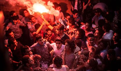 In this Tuesday, June 23, 2015, members of Ultras Nahdawy, a youth group of the Muslim Brotherhood, sing anti-army chants in a protest ahead of the second anniversary of the ouster of Islamist President Mohammed Morsi in the Nahia district, near Cairo, Egypt. Once sympathetic to the Muslim Brotherhood, some among the young protesters now resent it as weak and ineffectual. (AP Photo/Belal Darder)