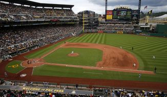 The Pittsburgh Pirates use a defensive shift  during an at-bat by Atlanta Braves' Nick Markakis during a baseball game in Pittsburgh, Sunday, June 28, 2015. (AP Photo/Gene J. Puskar)
