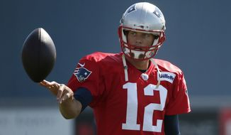 "New England Patriots quarterback Tom Brady was suspended four games for his role in the ""Deflategate"" scandal. (Associated Press)"
