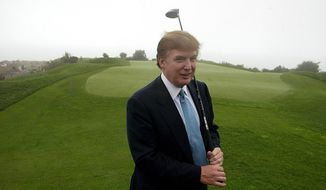 In this Nov. 9, 2002, file photo, Donald Trump holds a driver on the 11th green of his Ocean Trails Golf Club in Rancho Palos Verdes. (AP Photo/Damian Dovarganes, File) ** FILE **