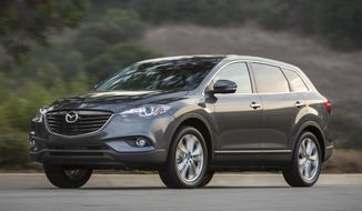 This undated photo provided by Mazda shows the 2014 CX-9 SUV. Mazda is recalling more than 193,000 CX-9 SUVs in the U.S. from the 2007 through 2014 model years to fix suspension parts that can rust and come loose, causing a loss of steering control. (Mazda via AP)