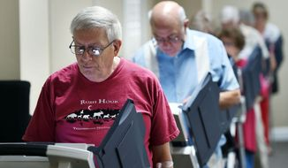 Ronnie Walters of Madison, Mississippi, casts his ballot Tuesday, Aug. 4, 2015, for the primary elections at the old Victory Church precinct on Old Canton Road in Madison, Miss. (Joe Ellis/The Clarion-Ledger via AP)