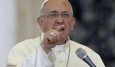 Pope Francis delivers his message on the occasion of an audience with participants of Rome's diocese convention in St. Peter's Square, at the Vatican, Sunday, June 14, 2015. Francis engaged in some self-promotion during his weekly blessing, alerting the thousands of people in St. Peter's Square that his first solo encyclical is coming out on Thursday and inviting them to pay attention to environmental degradation around them. (AP Photo/Gregorio Borgia)