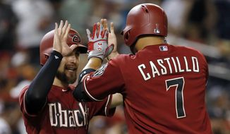 Arizona Diamondbacks' Welington Castillo (7) celebrates his three-run home run with Ender Inciarte during the eighth inning of a baseball game against the Washington Nationals at Nationals Park, Wednesday, Aug. 5, 2015, in Washington. The Diamondbacks won 11-4. (AP Photo/Alex Brandon)