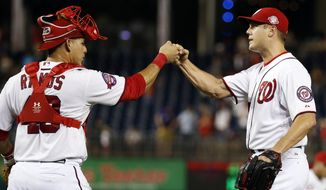 Washington Nationals catcher Wilson Ramos (40) and relief pitcher Jonathan Papelbon celebrate after a baseball game against the Arizona Diamondbacks at Nationals Park, Tuesday, Aug. 4, 2015, in Washington. The Nationals won 5-4. (AP Photo/Alex Brandon)