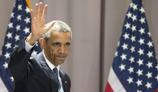 President Barack Obama waves as he leaves after speaking about the nuclear deal with Iran, Wednesday, Aug. 5, 2015, at American University in Washington. The president said the nuclear deal with Iran builds on the tradition of strong diplomacy that won the Cold War without firing any shots.  (AP Photo/Carolyn Kaster) ** FILE **