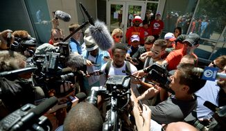 Kansas City Chiefs rookie running back LaVance Taylor is surrounded by the news media while giving an interview outside Scanlon Hall concluding an NFL football training camp practice, Friday, July 31, 2015, in St. Joseph, Mo. (Andrew Carpenean/The St. Joseph News-Press via AP)
