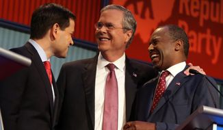 Republican presidential candidates from left, Marco Rubio, Jeb Bush and Ben Carson talk during a break during the first Republican presidential debate at the Quicken Loans Arena Thursday, Aug. 6, 2015, in Cleveland. (AP Photo/Andrew Harnik) ** FILE **