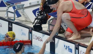 United States' Katie Ledecky is congratulated by her teammate Missy Franklin, right, after winning the gold medal in the women's 4x200m freestyle relay at the Swimming World Championships in Kazan, Russia, Thursday, Aug. 6, 2015. (AP Photo/Sergei Grits)