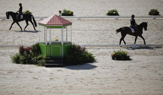 Brazilian athletes train in the Olympic Equestrian Center at the Deodoro Sports Complex in Rio de Janeiro, Brazil, Thursday, Aug. 6, 2015. The venue is part of the sports complex that will stage competitions for dressage, cross-country and jumping at the Olympics and Paralympics. (AP Photo/Leo Correa)