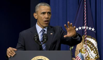 President Barack Obama speaks in the South Court Auditorium in the Eisenhower Executive Office Building on the White House complex in Washington, Thursday, Aug. 6, 2015, on the 50th anniversary of the Voting Rights Act. (AP Photo/Carolyn Kaster)