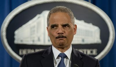 Former Attorney General Eric Holder pauses as he speaks at the Justice Department in Washington to discuss the Aug. 9, 2014, shooting in Ferguson, Mo. AP Photo/Carolyn Kaster, File)