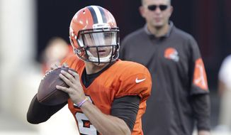 Cleveland Browns quarterback Johnny Manziel drops back to pass during an NFL football training camp scrimmage at Ohio Stadium on Friday, Aug. 7, 2015, in Columbus, Ohio. (AP Photo/Jay LaPrete)