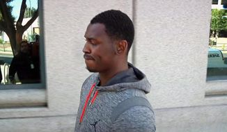 In this image made from video and provided by KNTV, San Francisco 49ers Aldon Smith walks past cameras after being released from the Santa Clara County Jail on Friday, Aug. 7, 2015 in San Jose, Calif.  Santa Clara Police arrested Smith on charges of hit and run, drunken driving and vandalism. (Michael Horn/KNTV via AP)
