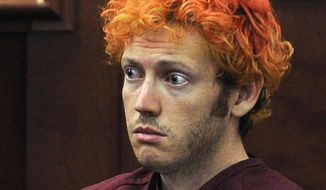 In this July 23, 2012, file photo, James Holmes, who was charged with killing 12 moviegoers and wounding 70 more in a shooting spree in a crowded theatre in 2012, sits in Arapahoe County District Court in Centennial, Colo. (RJ Sangosti/The Denver Post via AP, Pool, File)