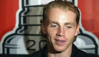 "FILE - In this July 17, 2015, file photo, Chicago Blackhawks' Patrick Kane speaks with reporters during the NHL hockey team's annual convention in Chicago. The NHL says it is ""following developments"" of a police investigation involving Chicago Blackhawks star Patrick Kane, Thursday, Aug. 6, 2015. (Daniel White/Daily Herald via AP, File) MANDATORY CREDIT; MAGS OUT"