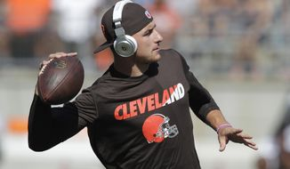 Cleveland Browns quarterback Johnny Manziel warms up before an NFL football training camp scrimmage game Friday, Aug. 7, 2015, in Columbus, Ohio. (AP Photo/Jay LaPrete)