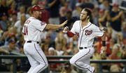 Washington Nationals' Bryce Harper, right, runs past third base coach Bob Henley, left, on his way home to score on a double by Ryan Zimmerman during the fourth inning of a baseball game, Friday, Aug. 7, 2015, in Washington. (AP Photo/Nick Wass) **FILE**