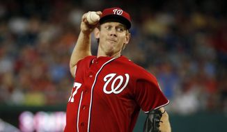 Washington Nationals starting pitcher Stephen Strasburg throws during the fourth inning of a baseball game against the Colorado Rockies at Nationals Park, Saturday, Aug. 8, 2015, in Washington. (AP Photo/Alex Brandon)
