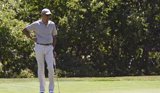 President Barack Obama plays golf on the first hole at Farm Neck Golf Course in Oak Bluffs, Mass., on Martha's Vineyard, Saturday, Aug. 8, 2015. The president is returning to his summer vacation spot of choice, the Massachusetts island of Martha's Vineyard, for more than two weeks of hoped-for rest coupled with extended pursuit of his favorite leisure sport: golf. (AP Photo/Susan Walsh)