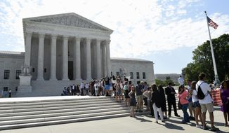 People wait in line to go into the U.S. Supreme Court in Washington, Monday, June 22, 2015. (AP Photo/Susan Walsh/File)