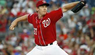 Washington Nationals starting pitcher Stephen Strasburg throws during the third inning of a baseball game against the Colorado Rockies at Nationals Park, Saturday, Aug. 8, 2015, in Washington. (AP Photo/Alex Brandon)