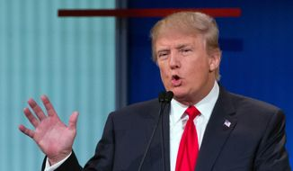 In this Thursday, Aug. 6, 2015, photo, republican presidential candidate Donald Trump participates in the first Republican presidential debate at the Quicken Loans Arena, in Cleveland. (AP Photo/John Minchillo) ** FILE **