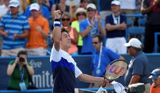Kei Nishikori celebrates after he beat John Isner 4-6, 6-4, 6-4, in a men's singles final match at the Citi Open on Sunday at the Rock Creek Park Tennis Center. (Associated Press)