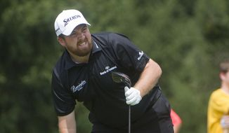 Shane Lowry, of Ireland, watches his tee shot on the fourth hole, during the final round of the Bridgestone Invitational golf tournament, in Akron, Ohio, Sunday, Aug. 9, 2015.  (AP Photo/Phil Long)