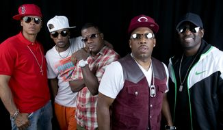 Members of the '80s Boston boy band New Edition from left, DeVoe, Ralph Tresvant, Ricky Bell, Michael Bivins and Johnny Gill pose in New York. BET and Jesse Collins Entertainment announced Monday, Aug. 10, 2015, that they are producing a still-untitled three-night miniseries chronicling New Edition.  Messrs. DeVoe, Tresvant, Bell, Bivins and Gill will serve as consultants and executive producers on the project. Not seen in the 2014 photo is founding member Bobby Brown, who was not mentioned in the statement announcing the project. (Photo by Amy Sussman/Invision/AP, File)