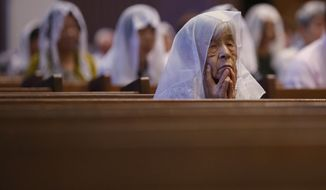 Catholics listen the preaching at an early morning mass to pay respect to the victims of the Nagasaki atomic bombing at the Urakami Cathedral in Nagasaki, southern Japan Sunday, Aug. 9, 2015. On two days in August 1945, U.S. planes dropped two atomic bombs, one on Hiroshima, one on Nagasaki, the first and only time nuclear weapons have been used.  (AP Photo/Eugene Hoshiko)