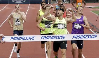 FILE - In this June 28, 2015, file photo, Nick Symmonds wins the 800 meter event at the U.S. Track and Field Championships in Eugene, Ore. Symmonds will be watching the world championships in Beijing from the sideline after being left off the U.S. squad over a uniform squabble. (AP Photo/Don Ryan, File)