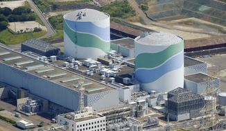 This aerial photo shows reactors of No. 1, right, and No. 2, left, at the Sendai Nuclear Power Station in Satsumasendai, Kagoshima prefecture, southern Japan, Tuesday, Aug. 11, 2015. Kyushu Electric Power Co. said Tuesday, Aug. 11, 2015, it had restarted the No. 1 reactor at its Sendai nuclear plant as planned. The restart marks Japan's return to nuclear energy four-and-half-years after the 2011 meltdowns at the Fukushima Dai-ichi nuclear power plant in northeastern Japan following an earthquake and tsunami.(Kyodo News via AP)