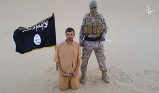FILE - This image made from a militant video posted on a social media site on Wednesday, Aug. 5, 2015, which has been verified and is consistent with other AP reporting, purports to show a militant standing next to another man who identifies himself as 30-year-old Tomislav Salopek, kneeling down as he reads a message at an unknown location.  An online image purports to show the Croatian hostage being held by an Islamic State affiliate in Egypt has been beheaded. (Militant video via AP, File)