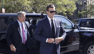New England Patriots quarterback Tom Brady arrives at federal court, Wednesday, Aug. 12, 2015, in New York. Brady and NFL Commissioner Roger Goodell are set to explain to a judge why a controversy over underinflated footballs at last season's AFC conference championship game is spilling into a new season. (AP Photo/Mary Altaffer)
