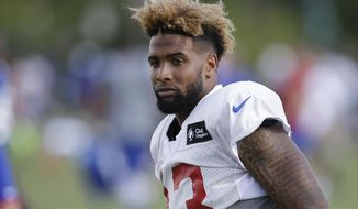 New York Giants wide receiver Odell Beckham Jr. turns to walk back toward the locker rooms after a joint NFL football training camp with the Cincinnati Bengals, Wednesday, Aug. 12, 2015, in Cincinnati. (AP Photo/John Minchillo)