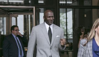 Michael Jordan leaves the U.S. courthouse Tuesday, Aug. 11, 2015, in Chicago. after the first day of his civil trial against the defunct grocery-store chain Dominick's Finer Foods for using his name and jersey number without permission. (Ashlee Rezin/Sun-Times Media via AP) **FILE**