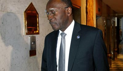 FILE - In an Aug. 25,  2012 file photo, Lt. Gen. Babacar Gaye, the head of the failed United Nations Supervision Mission in Syria, drags his luggage as he departs his residence at the Dama Rose hotel in Damascus, Syria. Gaye, the head of the U.N. peacekeeping mission in the Central African Republic, resigned Wednesday, Aug. 12, 2015, at the request of U.N. Secretary-General Ban Ki-moon, over the force's handling of a series of sexual and other misconduct allegations. Ban Ki-moon has called a special session of the U.N. Security Council for Thursday over the issue of sexual abuse allegations that has rocked the world body.  (AP Photo/Bassem Tellawi, File)