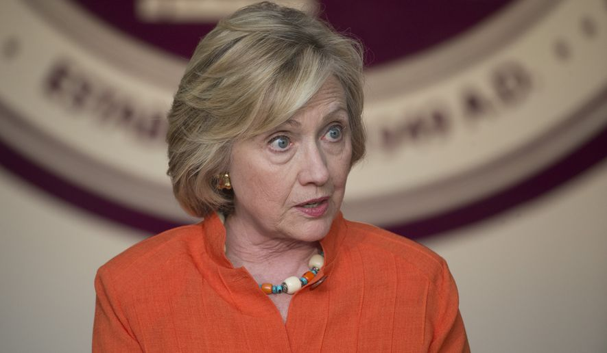 Federal officials have known since May that Hillary Rodham Clinton's State Department email included classified information, according to a report Thursday night by McClatchy News. (Associated Press)