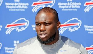 Buffalo Bills' IK Enemkpali speaks to the media at NFL football training camp in Pittsford, N.Y., on Aug. 13, 2015. The Bills claimed the second-year player off of waivers a day after he was released by the Jets because he hit quarterback Geno Smith with a sucker punch, breaking his jaw. (Associated Press) **FILE**