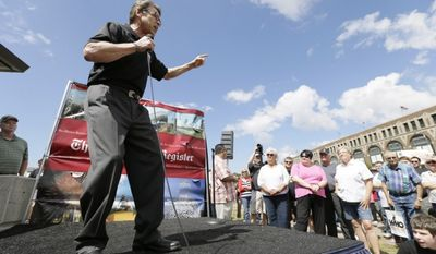 """Rick Perry gets into it with the grassroots audience at the Iowa State Fair """"soapbox"""" in 2014. (AP Photo)"""