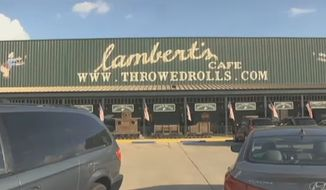 "Troy Tucker is suing Lambert's Cafe, a Missouri restaurant dubbed ""Home of Throwed Rolls,"" after she was allegedly hit in the eye with an airborne dinner roll, causing a lacerated cornea. (KFVS)"