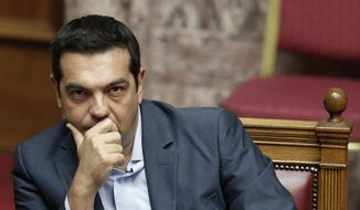 Greek Prime Minister Alexis Tsipras listens during a parliamentary session in Athens on Aug. 14, 2015. (Associated Press) **FILE**