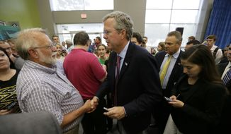 Republican presidential candidate former Florida Gov. Jeb Bush greets supporters following a forum sponsored by Americans for Peace, Prosperity and Security, Thursday, Aug. 13, 2015, at St. Ambrose University in Davenport, Iowa. (AP Photo/Charlie Neibergall)