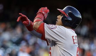 Washington Nationals' Yunel Escobar celebrates after hitting the first pitch of the game for a home run off San Francisco Giants pitcher Ryan Vogelsong in the first inning of a baseball game Thursday, Aug. 13, 2015, in San Francisco. (AP Photo/Ben Margot)