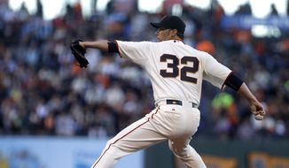 San Francisco Giants pitcher Ryan Vogelsong works against the Washington Nationals in the first inning of a baseball game Thursday, Aug. 13, 2015, in San Francisco. (AP Photo/Ben Margot)