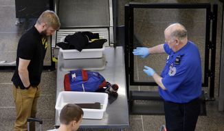 Investigators who ran tests at eight airports during an unspecified time attributed screeners' failure to detect anomalies and potential security threats to problems with technology, Transportation Security Administration procedures and human error. (AP Photo/File)