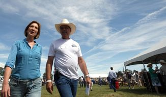Republican presidential candidate Carly Fiorina is escorted by Tom Stone from Gardnerville, Nevada, after arriving at the Inaugural Basque Fry at Corley Ranch in Gardnerville on Aug. 15, 2015. (Associated Press)